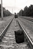 Suitcase standing left on railroad Royalty Free Stock Photography