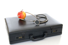 Suitcase stethoscope apple Royalty Free Stock Images
