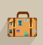 Suitcase with stickers icon Stock Photos