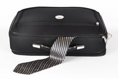 Suitcase with a sticking out tie Stock Images