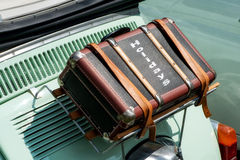 Suitcase strapped to a vintage car Royalty Free Stock Photo