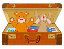 Suitcase with stuffed animals Royalty Free Stock Photo