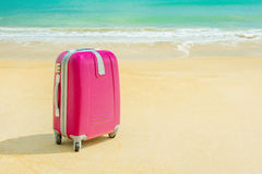 Suitcase at the sunny beach Royalty Free Stock Photography