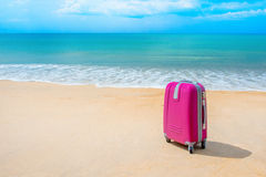 Suitcase at the sunny beach Stock Photo