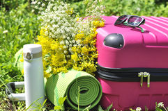 Suitcase with thermos and yoga mat Royalty Free Stock Photography