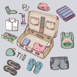 Suitcase with things clothing for travelling Stock Photos