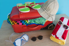Suitcase with things for spending summer vacation. Anticipation of voyage. Women`s clothes and accessories in suitcase Stock Photos