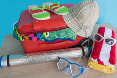 Suitcase with things for spending summer vacation. Anticipation of voyage. Women`s clothes and accessories in suitcase Royalty Free Stock Photography