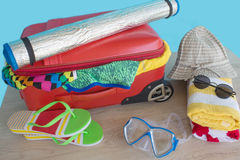 Suitcase with things for spending summer vacation. Anticipation of voyage. Women`s clothes and accessories in suitcase Royalty Free Stock Photos