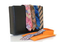 Suitcase with ties and shirt Stock Images