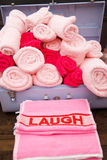 Suitcase of towels and laugh Royalty Free Stock Images
