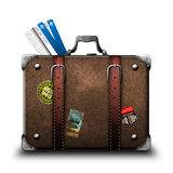 Suitcase traveler with stickers and air tickets Stock Photography