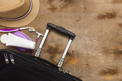 Suitcase traveler and toiletries. Royalty Free Stock Image
