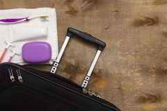 Suitcase traveler and toiletries. Royalty Free Stock Photo