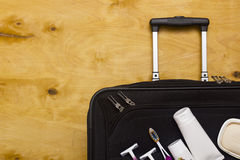 Suitcase traveler and toiletries. Stock Photo