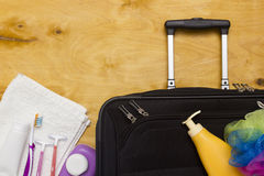 Suitcase traveler and toiletries. Stock Images