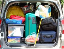 Suitcase in the trunk of the car for family vacations. Large suitcase in the trunk of the car for family vacations stock photo