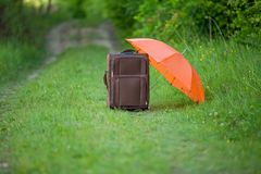 Suitcase with umbrella Royalty Free Stock Image
