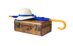 Suitcase, umbrella and hat on white background stock photography