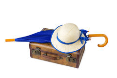 Suitcase, umbrella and hat on white background royalty free stock image