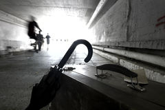 Suitcase and umbrella in an underpass Stock Image