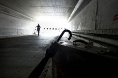 Suitcase and umbrella in an underpass stock photography