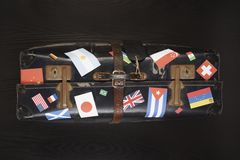 Suitcase with various flag stickers studio shot Stock Photos