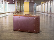 Suitcase vintage retro in airport lobby. Concept of tourism and Royalty Free Stock Images