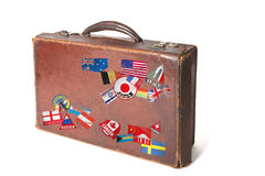 Suitcase with wolrd stickers and stamps Royalty Free Stock Images