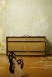 Suitcase on wooden floor Royalty Free Stock Photography
