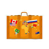Suitcase with world map and flags Stock Photo