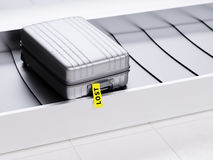 Suitcase with Yellow Lost Sticker on Baggage Transporter 3d Illustration. Plastic Suitcase with Yellow Lost Sticker on Baggage Claim Transporter 3d Illustration Royalty Free Stock Images