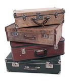 Suitcases. Four old Russian suitcases on a white background Stock Photography