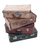 Suitcases. Four old Russian suitcases on a white background Stock Photos