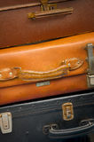 Suitcases. Background of old battered suitcases stacked for traveling Royalty Free Stock Photos