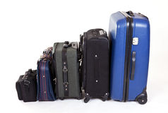 Suitcases. In a row isolated on white background Stock Photo