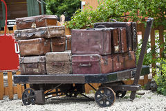 Suitcases. Old suitcases / luggage on vintage trolley Royalty Free Stock Photography