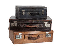 Suitcases. Stack of three antique suitcases isolated on white Stock Photography