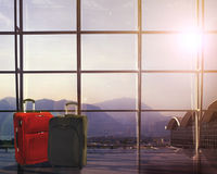 Suitcases in airport departure lounge, summer vacation concept, traveler suitcases in airport terminal waiting area Stock Photo