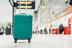 Suitcases in airport departure terminal with traveler people walking in background,Holiday vacation concept, Business. Trip,selective focus on suitcases royalty free stock image