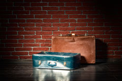 Suitcases on a background of red brick wall Stock Photo