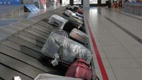 Suitcases on the baggage conveyor belt at the airport. 4k stock video