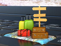 Suitcases, bags on the keyboard on the world map, a pointer. Vac. Ation, Travel Stock Photo