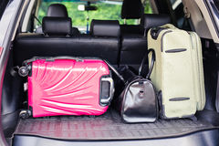 Suitcases and bags in trunk of car ready to depart for holidays Stock Image