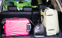 Suitcases and bags in trunk of car ready to depart for holidays Stock Images