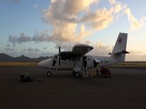 Suitcases being removed from a twin otter in the grenadines. Luggage  arriving by 'plane at bequia in the windward islands stock footage