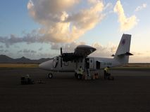 Suitcases being removed from a twin otter in the grenadines. Luggage  arriving by 'plane at bequia in the windward islands stock video