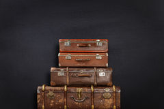 Suitcases on black background Royalty Free Stock Image