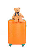 Suitcases and brown teddy bear Stock Photos