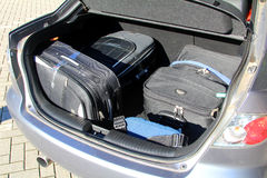 Suitcases in a car luggage carrier. Image of the suitcases in a car luggage carrier Royalty Free Stock Image